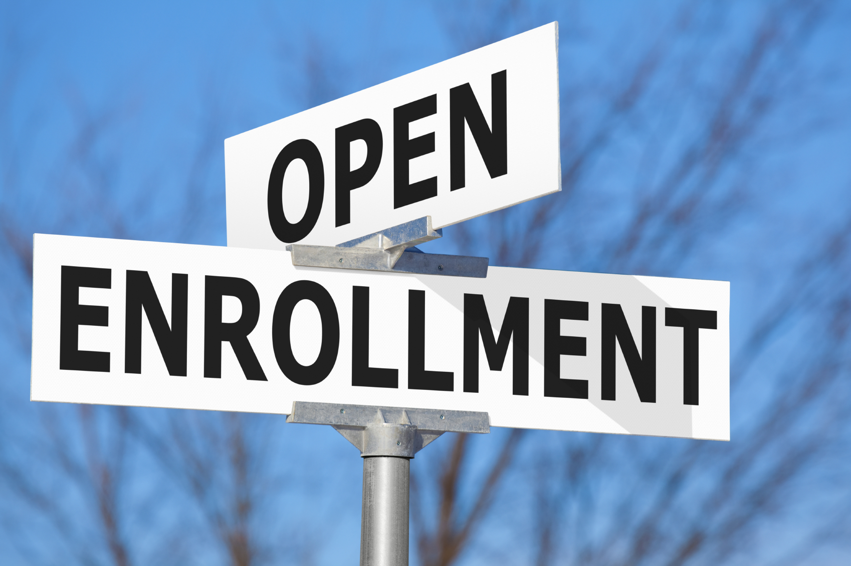 Intersecting street sign that says Open Enrollment